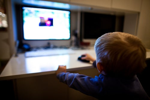 cute kid clicking a mouse
