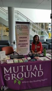 Director of Volunteer Services staffing an educational event at a local community college
