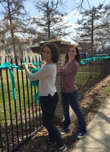 Volunteers tied green ribbons to the Mutual Ground property fence to raise awareness for National Sexual Assault Awareness month in April 2015