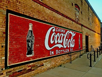 old-fashioned coke sign on a building