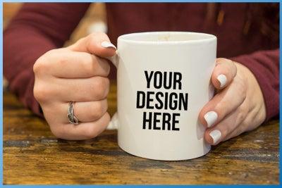 person holding custom coffee mug