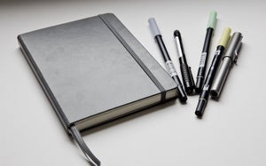notebook with pens