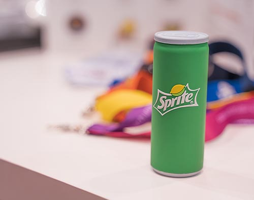 Wireless charger designed to look like a small can of Sprite. Design is green with a graphic sprite logo which features a lemon and lime.